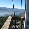My solution was to place my Buddipole mast's tripod in the southeast corner of the lookout deck and angle the mast out over the cliff so that it would clear the roof line. I used bungees to secure the mast to the tripod and the tripod to the lookout deck's railing. In the background is the Truckee River canyon with I-80 winding its way up into California from Nevada.