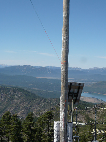 A closeup of the flag pole tie-off. That's Boca Reservoir to the right of the pole, and the Northstar ski resort is to the left. The highest peak that you see at Northstar is Mt. Pluto (W6/NS-138). I have a season ski pass at Northstar so I'll probably save that one for a winter activation.