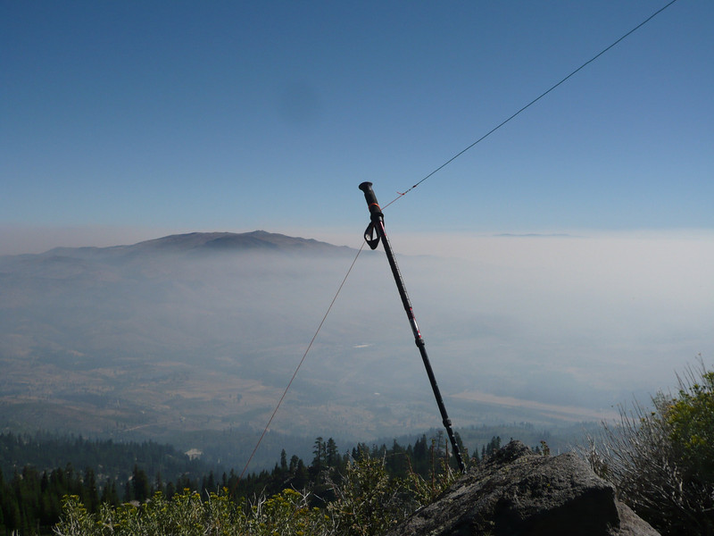 Tying off the north end of the dipole was a bit trickier. There were no available supports, so I used my hiking pole. There was just barely enough room left on that end of the ridge for the hiking pole.