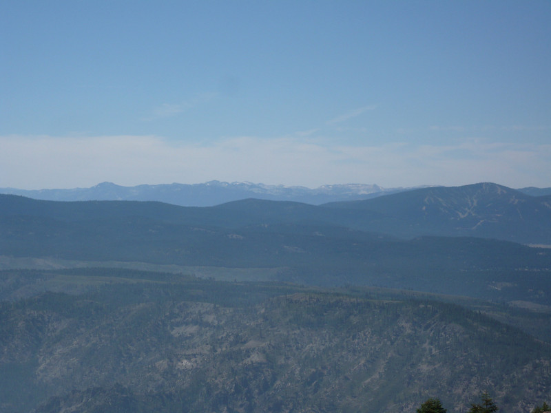 "To the south, <a href=""http://www.grizzlyguy.com/HamRadio/SOTA-Activation-MtPluto"">Mt. Pluto (W6/NS-138, part of the Northstar ski resort)</a> is to the right in this shot. The mountains in the distance on the skyline near the center are on the other (southwest) side of Lake Tahoe and include the many SOTA summits within Desolation Wilderness."