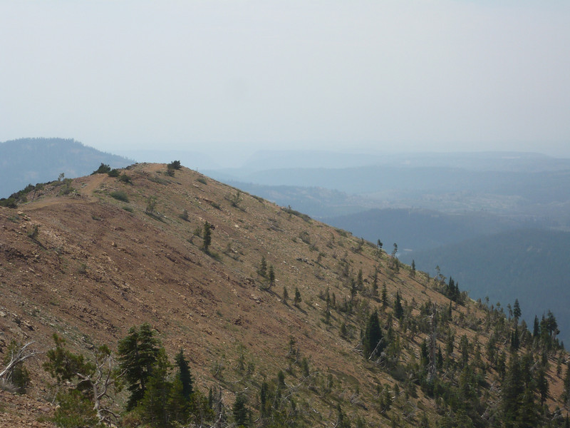 The spur ridge to the southwest of the summit. The historic stone lookout building where I had planned to operate is at the end of the ridge, just below the camera's line of sight.