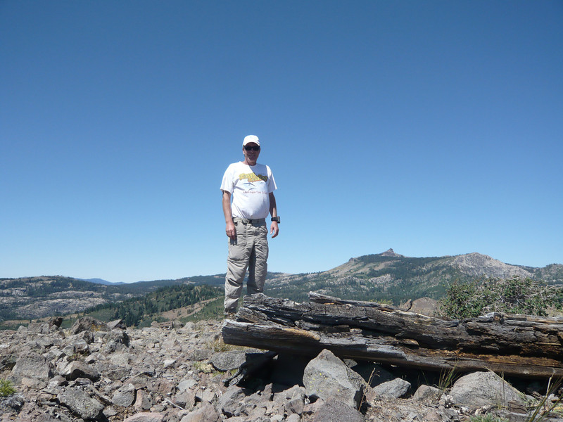Standing at the summit of Donner Ridge with Castle Peak (W6/SN-038) jutting onto the skyline behind me and to the camera's right. The weather was perfect today for an activation. It isn't always, as Donner Ridge is named after George Donner, the leader of 87 brave pioneers who attempted to cross the Sierra near here in a wagon train back in 1846. Most of them perished just a few miles from where I'm standing due to an exceptionally strong early season snow storm. They were trapped below Donner Ridge in two different locations, with no way to continue westward across the Sierra or back down into Nevada, and resorted to cannibalism to try and stay alive until spring. A few of the stronger ones did manage to press on to the west and were eventually rescued. The rescue mission that was dispatched from the west found a handful more still alive down below the ridge.<br /> <br /> P.S. - My gut and legs aren't that fat, the wind is blowing from behind me and puffing everything out.