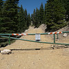 Approximately 440 vertical feet below the summit the road is gated. Vehicles aren't allowed to proceed any further.