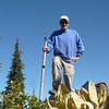 Standing on the summit with my foot on the small pile of rocks. Wooly Mule Ear leaves are in the foreground blocking the view of the rocks. I'm holding my 28-foot Jackite Pole that I brought along because I wasn't sure if there would be high trees on top of the ridge. It turns out that there are plenty of trees, but the wind has wreaked havoc with them as you will see in the pictures that follow.
