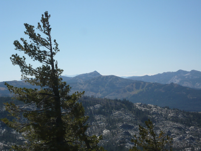 A view of the mountains near Donner Summit with thousands (millions?) of acres of granite visible in the foreground below.