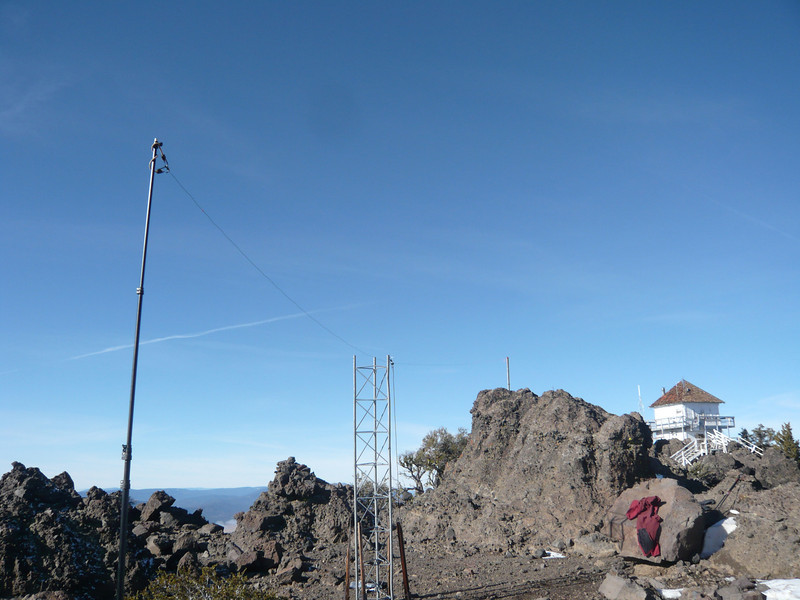This is the 20m dipole antenna that I erected. The tower is supporting the center insulator and coax. The north end is being supported by the pipe-in-rock, and my Buddipole collapsible mast is holding up the south end.  The antenna runs generally north-south, so it's biggest lobes (er, the most signal) will be in the east-west directions. Perfect! Of course I really had no other choice of orientation given where these items happened to be.<br /> <br /> Note to self: gotta buy a lottery ticket soon, before this lucky streak runs out... ;-)
