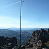 "The Buddipole mast is holding up the south end of the dipole via a bungee cord and the nifty itty-bitty carabiner that I ""discovered"" on my backpack during my Virginia Peak activation a few days earlier. <br /> <br /> I radioed up to the pilot of a micro-jet and asked him to fly right through the middle of the bungee loop to test its integrity. As you can see, he obliged me and the bungee held up fine. ;-)"