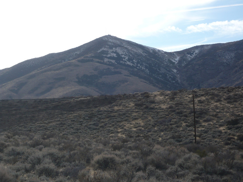 Peavine Peak as seen from the east down on the paved North Virginia Street in Reno. The dirt and gravel (and unmarked) Peavine Road takes off from near here and climbs all the way to the top. I'll drive most of the way to the top, but do the final climb on foot as per SOTA rules.