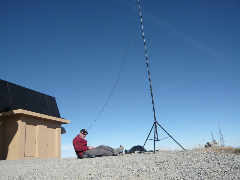 It started out calm, then the wind suddenly picked  up from behind me. I quickly put my jacket back on and held the coax in my teeth while operating so as to help keep the antenna from being blown off the edge! Sorry for my QLF moments (QLF means sending with your left foot). ;-)