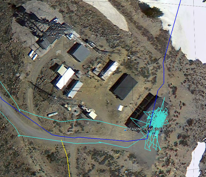 "The Google Earth view zoomed in. The ""splotch"" of turquois is my Garmin Foretrex 401 wrist-mounted GPS tracking me moving around the operating position. The dark blue line is a track from a previous ATV ride.<br /> <br /> Thanks to all who worked me and 73 (best regards) until next time on some other summit!"