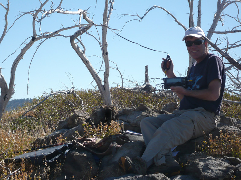 With the twinlead routed this way and that way through the dead trees, I'm ready to roll. My Elecraft KX3 transceiver is in my left hand and my right hand is holding a 4:1 QRP balun from Balun Designs. I use a 1-foot long piece of RG-58 with BNC male connectors on each end to connect to the KX3. This system works on all bands 6m - 80m and changing bands is a simple matter of hitting the ATU button and waiting a few seconds for it to tune. I verified that the antenna tuned to a VSWR of less than 1.5 to 1 on all bands, and I made QSOs on 10m, 17m, 20m, 30m and 40m. I called CQ on 12m and 80m, was auto-spotted by the new RBNGate software that I created, but had no takers on those bands. The antenna wouldn't load on 160m, but I included a small loop and connector on each end so that I can easily turn it into a 135' link doublet by adding two chunks of wire attached by zip ties. This will be handy for activations when I camp on the summit. I've made one 160m QSO from a summit so far (with Skip K6DGW) and I'd like to make more.