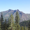 "Sierra Buttes (W6/NS-139) on the other side of the Yuba River Canyon (Highway 49 runs along the bottom of the canyon). The lookout tower is on the peak to the left. See <a href=""http://www.grizzlyguy.com/HamRadio/SOTA-Activation-9202012-Sierra"">my Sierra Buttes activation album</a> for more info."