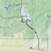 Dixie Mountain is in Plumas National Forest, west of Frenchman Lake. To get there, take highway 70 to the town of Chilcoot and turn north onto the paved Frenchman Lake Road. When you reach the intersection near the dam, bear left. The pavement will end at the DIXIEVALLEY point (39.90857N, 120.21249W) and turn into a well maintained gravel road. At the C176P24N02Y point (39.95174N, 120.21087W), turn left onto a rough 2WD road that will likely require 4WD to get up the last few switchbacks near the peak, which are steeper and covered with loose rock.