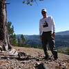 I'm standing near my pine tree at the edge of the steep downslope, and wearing a long-sleeved Northern Sierra T-shirt.