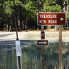 The sign for Treasure Mountain Road. This is within just a few hundred feet of Highway 89, and is before you reach the large asphalt parking lot (OHV staging area) that is just a hundred feet or so further.