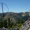 """Looking south with Red Hill behind the right edge of the loop and just below the skyline. Bowman Mountain W6/NS-218 is the one that appears to be cutting through my neck (<a href=""""http://www.grizzlyguy.com/HamRadio/SOTA-BowmanMtn-W6NS218"""">I activated it a few days earlier</a>), and the peak on the skyline between them and further back is Fall Creek Mountain W6/NS-209. Grouse Ridge W6/NS-195 is on the skyline behind Red Hill. <a href=""""http://www.grizzlyguy.com/HamRadio/SOTA-Activation-10172012"""">I activated Grouse Ridge two years ago</a>."""