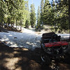 Four different forest service roads climb up onto the mountain and I chose the most south-facing route for my Yamaha Grizzly 700 ATV, expecting all of the snow to be melted. It was, except for the final section that begins below the locked gate and loops around the north side of the mountain and on up to the summit. No worries, I planned to begin my hike from this spot anyway. <br /> <br /> Unfortunately, I was so confident that there would be no snow that I wore only my low-top hiking shoes. Up around the bend beyond the gate, the drifts were still 3-4 feet deep and I had to post-hole my way through them to the top. It was a warm day and the snow that packed itself into my shoes actually felt refreshing!