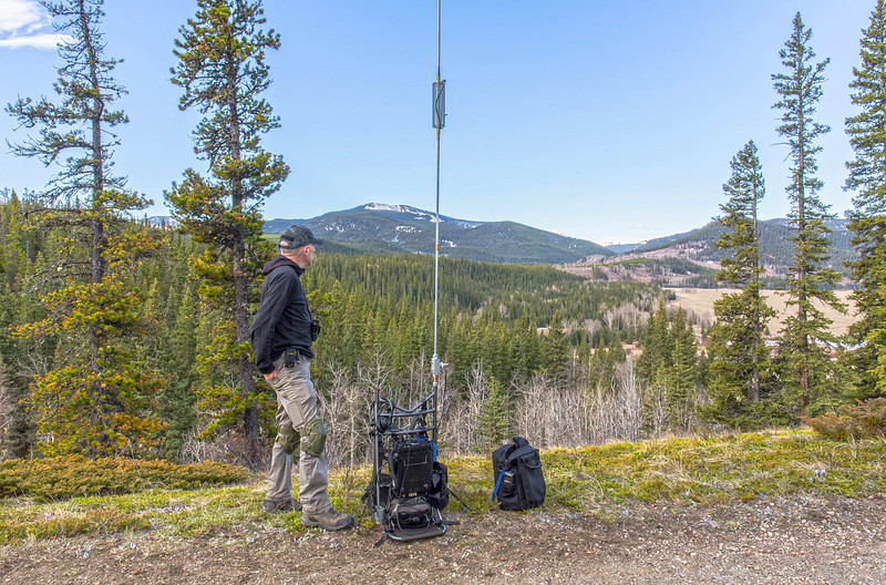 "In this photo, I've set up my portable station on a high ridge in the Rockies, and with the wind a factor on this day, I have my manpack guyed to the ground with a combination of 550 paracord and tent pegs.<br /> <br /> This works quite well, with the 20' vertical antenna moving about in the wind, but not going anywhere.<br /> <br /> Expand the photo for a closer look.....<br /> <br /> Read about my day here.....<br /> <a href=""http://ve6ab.blogspot.ca/2017/05/portable-hf-operations.html"">http://ve6ab.blogspot.ca/2017/05/portable-hf-operations.html</a>"