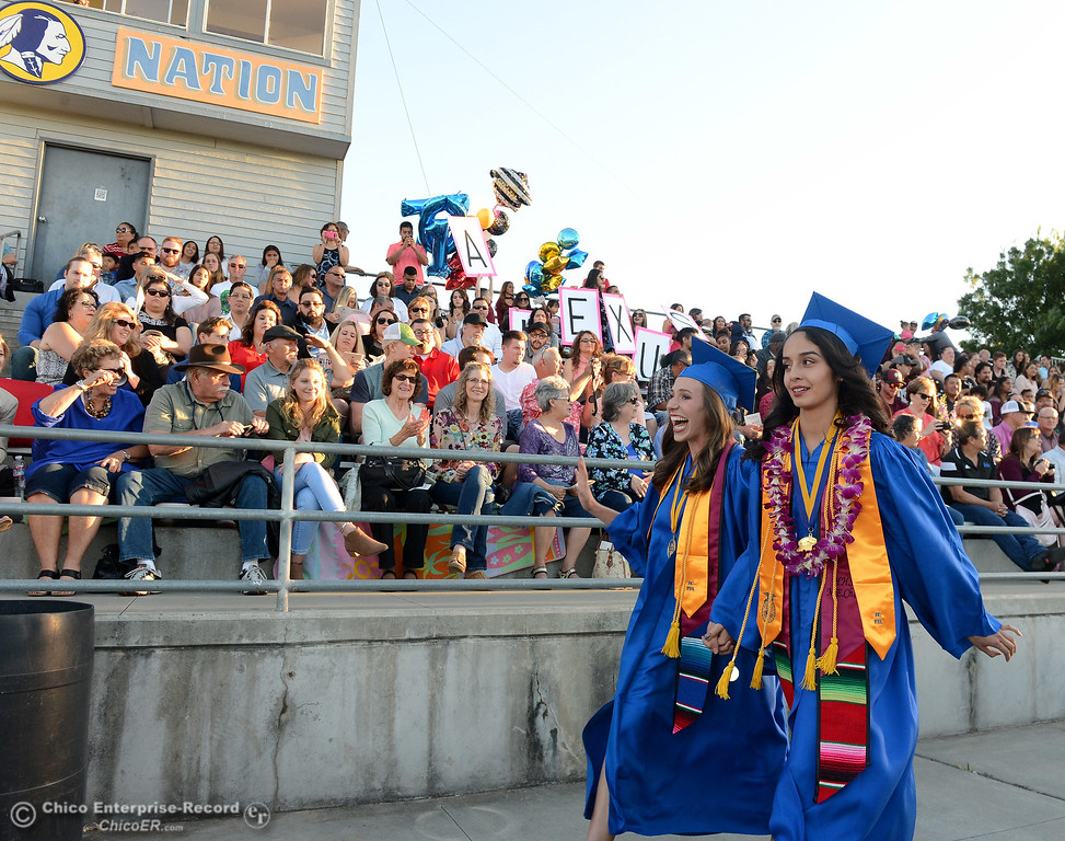. Two of Hamilton High\'s valedictorians, Kelly Koehnen, left, and Lilia Diaz, right, enter the stadium to take the stage with their classmates as seniors graduate Friday, June 9, 2017, in Hamilton City, California. (Dan Reidel -- Enterprise-Record)