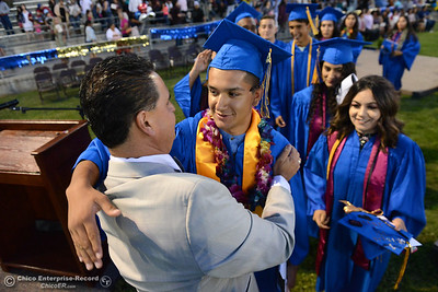 Hamilton High principal Cris Oseguera, left, hugs students as seniors graduate Friday, June 9, 2017, in Hamilton City, California. (Dan Reidel -- Enterprise-Record)
