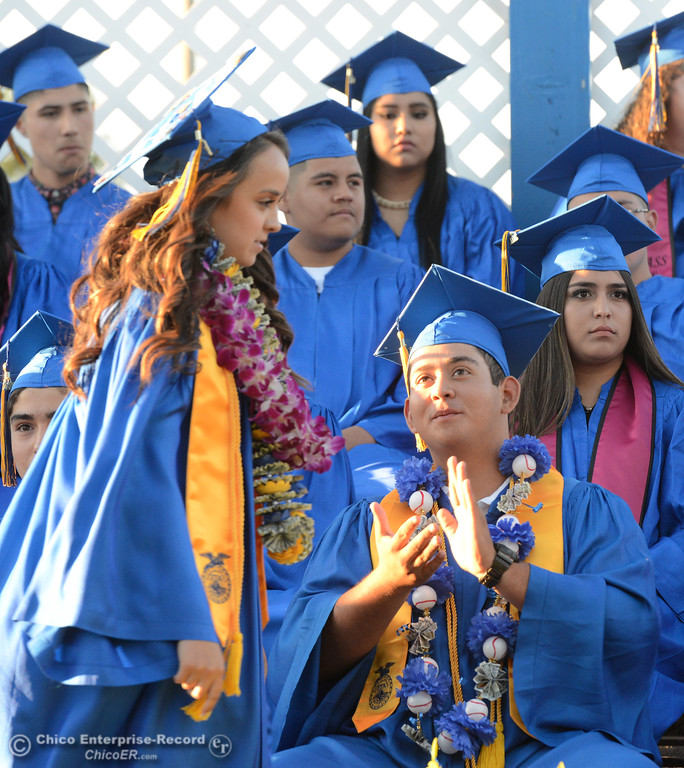 . Ana Maria Ramirez, left, steps up to the microphone for the welcome address as Cristobal Llamas, right, claps for her as Hamilton High seniors graduate Friday, June 9, 2017, in Hamilton City, California. (Dan Reidel -- Enterprise-Record)