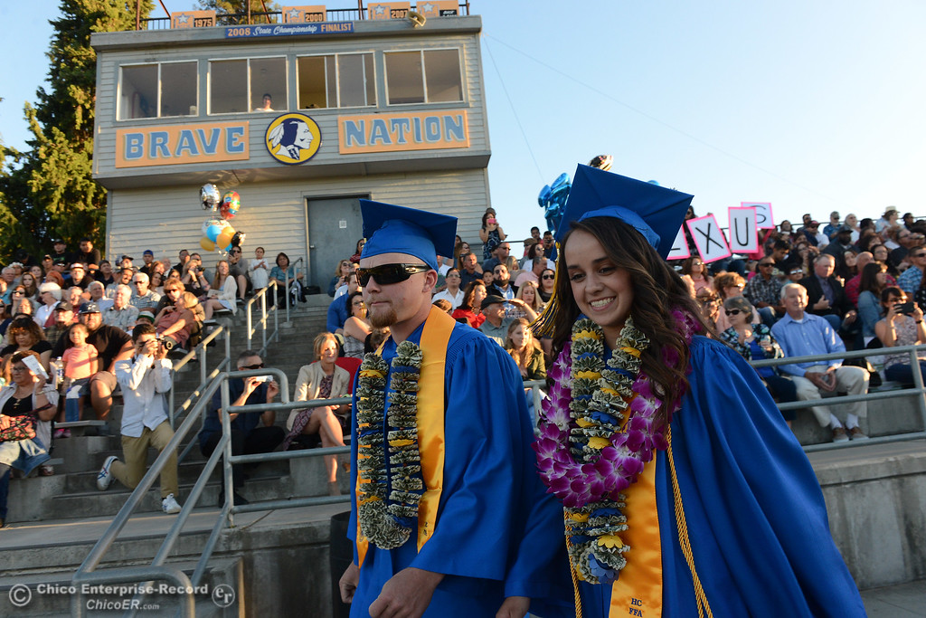 . Connor Zuppan, left, and Ana Maria Ramirez, right, enter the stadium and take to the stage as Hamilton High seniors graduate Friday, June 9, 2017, in Hamilton City, California. (Dan Reidel -- Enterprise-Record)