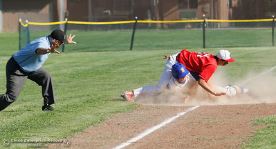 Hamilton High's Riley Meridith breaks up the tag out by Enta's Steve Lampert at third during the Northern Section Division V semi-final baseball game May 17, 2016 in Hamilton City, Calif. (Emily Bertolino -- Enterprise-Record