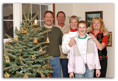 Family by Christmas Tree
