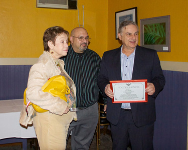 Judy Heyman, vice-president and Joseph Bruno, president; present former president Sam Moffa with a certificate of appreciation at the Focal Point Christmas Party at Rocco's Town House.