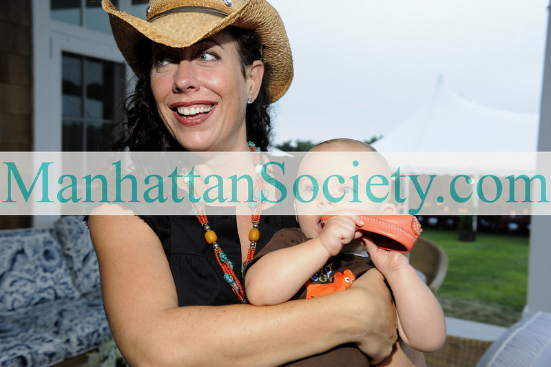 WATERMILL-AUGUST 22: Tatiana Platt with son Fox Platt attend BEST BUDDIES Hamptons Gala 2009 on Friday, August 21, 2009 at the home of Anne Hearst McInerney & Jay McInerney, Watermill, New York (Photo Credit: ©ManhattanSociety.com by Gregory Partanio)