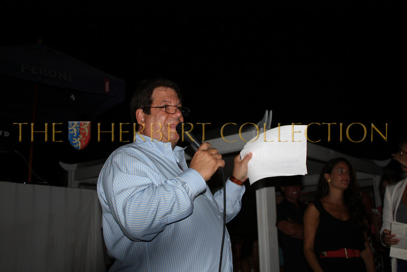 Mitchell Modell conducts live auction