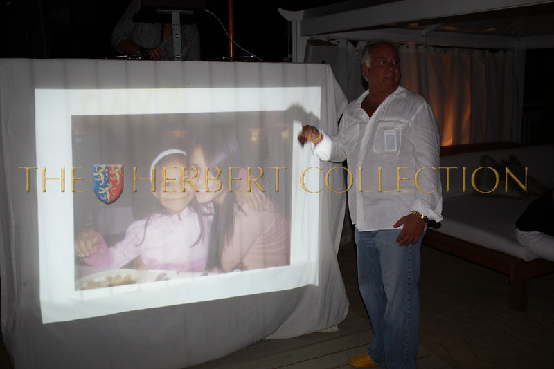 Jeff Winick shows guests his daughter Danielle's photo with a child helped by Operation Smile