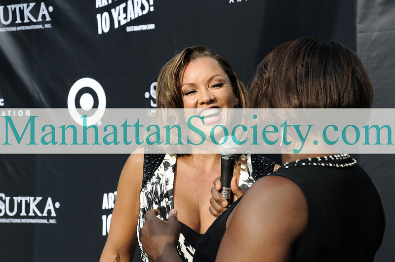 EAST HAMPTON-JULY 18: Vanessa Williams gets interviewed at Rush Philanthropic Arts Foundation's 10th Anniversary ART FOR LIFE Benefit on Saturday, July 18, 2009 at Russell Simmons' East Hampton Estate, East Hampton, New York (Photo Credit: ManhattanSociety.com by Gregory Partanio)