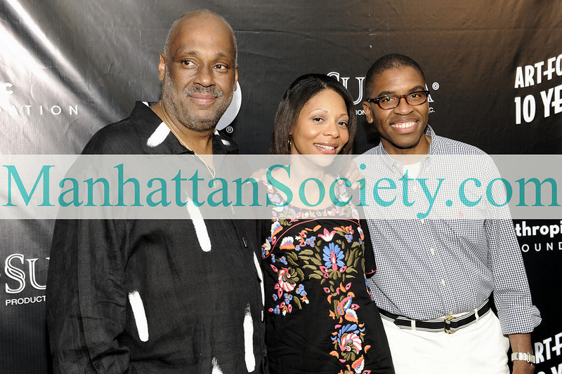 EAST HAMPTON-JULY 18: Danny Simmons, Jillian Canal, Reggie Canal attend Rush Philanthropic Arts Foundation's 10th Anniversary ART FOR LIFE Benefit on Saturday, July 18, 2009 at Russell Simmons' East Hampton Estate, East Hampton, New York (Photo Credit: ManhattanSociety.com by Gregory Partanio)