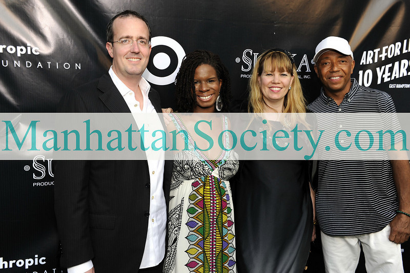EAST HAMPTON-JULY 18: Chip Brady, Tangie Murray, Allison Weiss-Brady, Russell Simmons attend Rush Philanthropic Arts Foundation's 10th Anniversary ART FOR LIFE Benefit on Saturday, July 18, 2009 at Russell Simmons' East Hampton Estate, East Hampton, New York (Photo Credit: ManhattanSociety.com by Gregory Partanio)