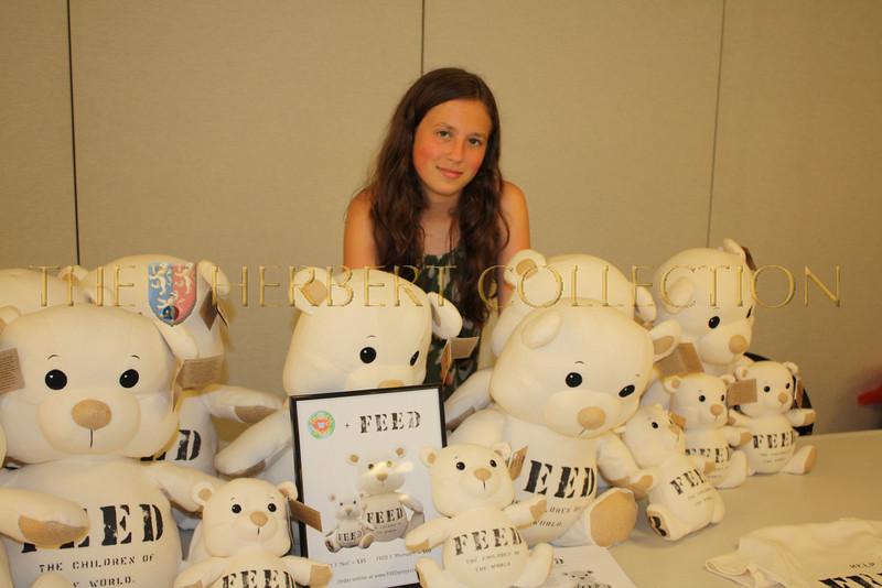 Alana Morgan Galloway surrounded by FEED bears