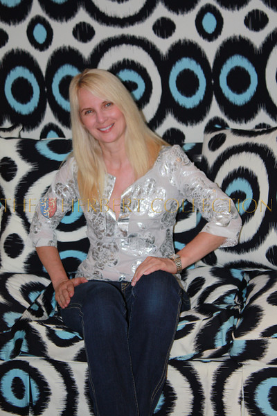 Sara Herbert-Galloway, wearing Tory Burch tries out the psychadelic sofa at Tory Burch