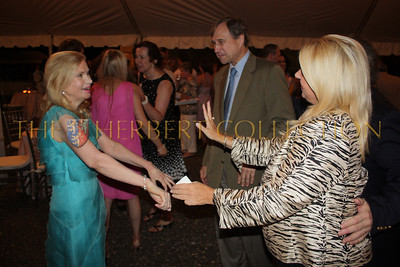 Tricia Nixon Cox dances with Rita Cosby as Ed Cox looks on