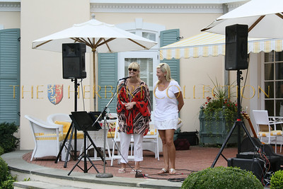 Marcy Warren and Avis Richards welcome guests