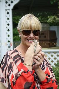 Marcy Warren holds snake