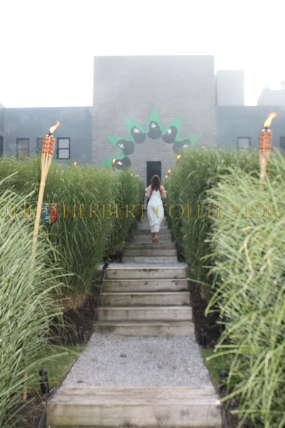 """Guests ascend the torch lit stairs to enter """"Paradiso,"""" The Byrd Hoffman Watermill Foundation"""