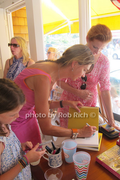 Chesie Breen autographing Park Ave. Pot Luck Celebrations cookbook