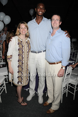 Honoree Allison Weiss Brady, Miami Heat baskeball star Chris Bosh, and honoree Chip Brady<br /> attend the Art for Life 2010 gala at the estate of Russell Simmons in East Hampton on July 24, 2010. photo by Rob Rich/SocietyAllure.com