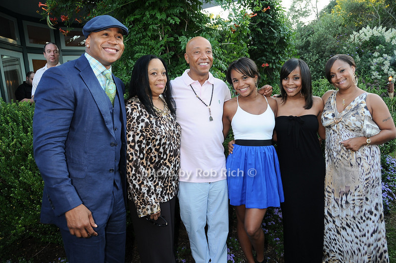 L.L.Cool J with family and Russell Simmons <br /> photo by Rob Rich © 2010 robwayne1@aol.com 516-676-3939