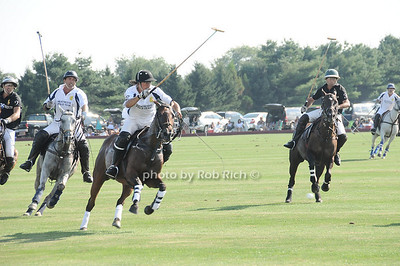 Playing Polo at the Mercedes Benz Polo Challenge at BlueStar Jets field in Bridgehampton on July 31, 2010. photo by Rob Rich/SocietyAllure.com