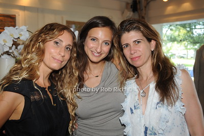 From left, Laura Rubon, Michelle Swirly and Georgie Benardete attend David Heath Adventure Photographer Raises Funds to Give  Back to Myanmar during book signing at Urban Zen boutique in Sag Harbor. July 23, 2016.
