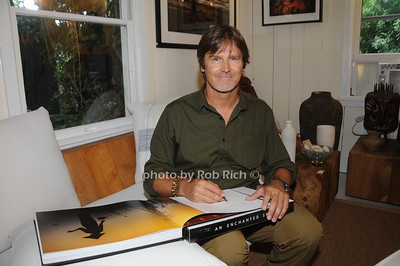 David  Heath signing books he is a Adventure Photographer  who Raises Funds to Give  Back  to Myanmar during book signing at Urban Zen boutique in Sag Harbor. July 23, 2016.