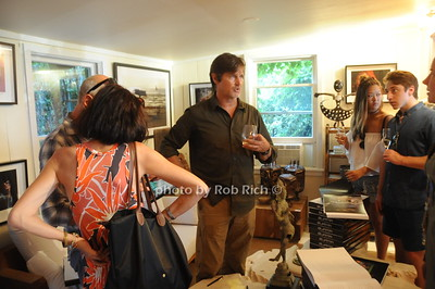 David Heath (center) talks about his  Adventure Photography to  Raises Funds to Give  Back  to Myanmar during book signing at Urban Zen boutique in Sag Harbor. July 23, 2016.