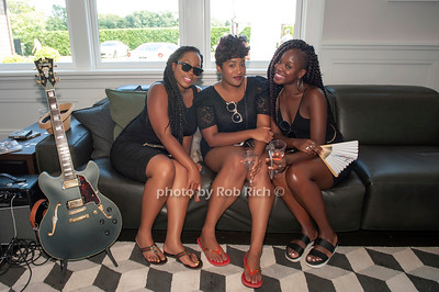 Zaire Prosper, Brittany Sacichar and Akela T. Moore  explore the luxury guitars at  the Rand Luxury event at a private residence in Bridgehampton on August 7,2016.