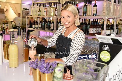"""Shannon Stiggins from Oreya Restaurant pours a cocktail  at  the Samuel Waman Cancer Research Foundation 12th.Annual """"A Hamptons Happening"""" at the private residence of Ken and Maria Fishel in Bridgehamton on July 9, 2016."""